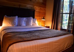 Large bed with black walnut headboard grand vue park